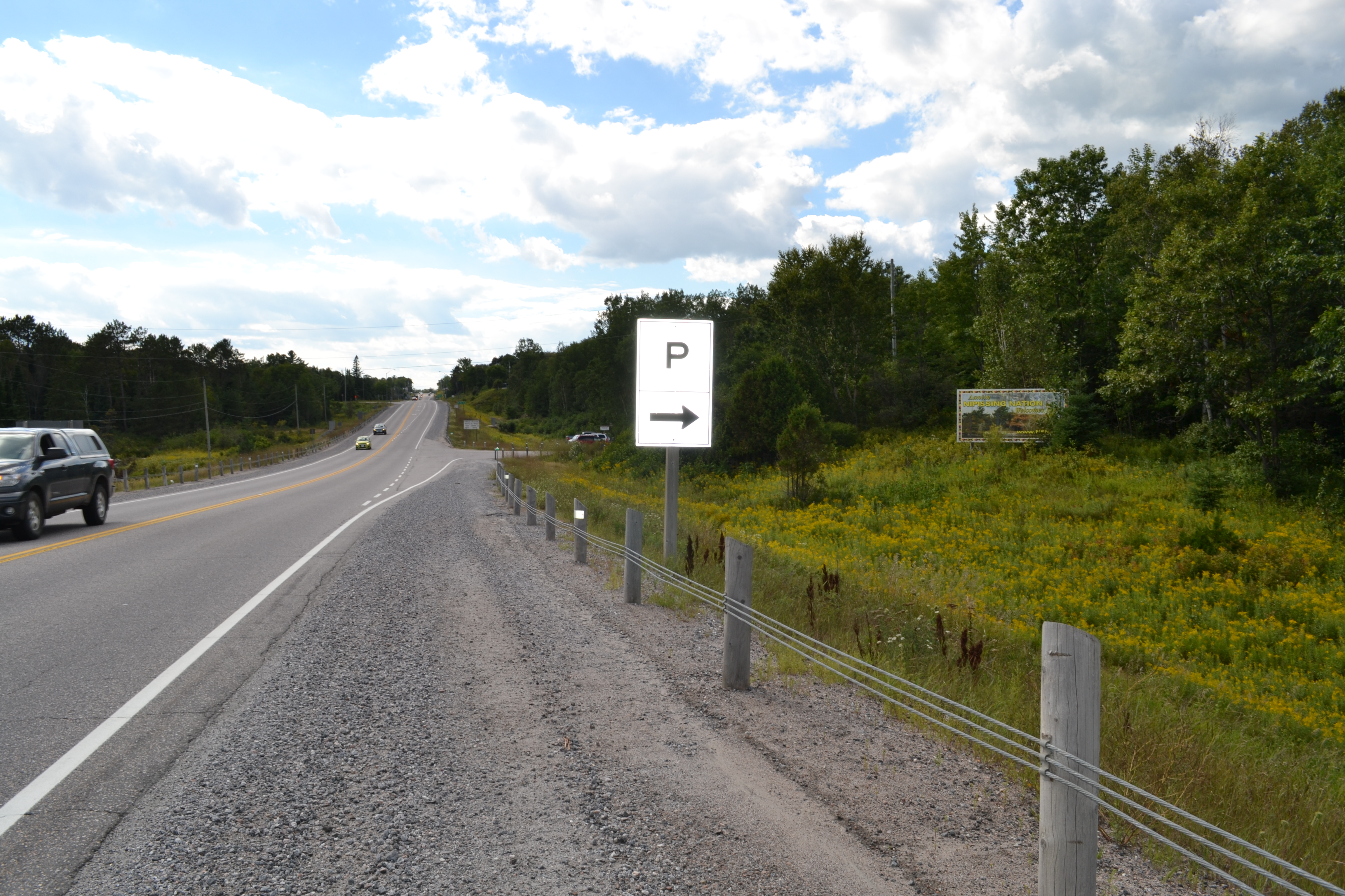 Parking sign points to Duchesnay Trail parking lot